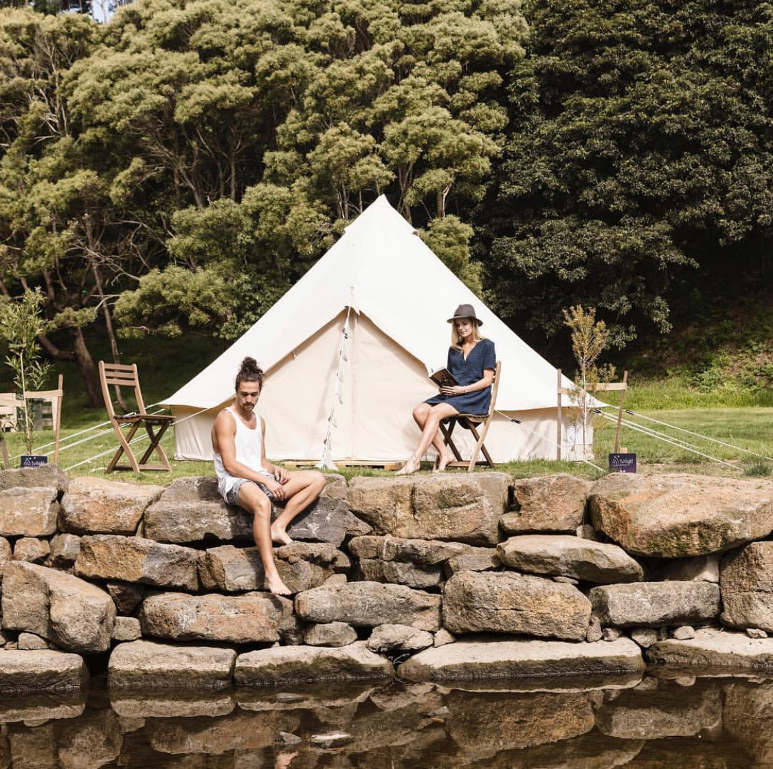 Bell tent and two guests glamping along the river at Wye River